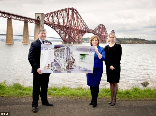Commemoration: Britain's first plastic banknotes are set to enter circulation in March 2015 to mark the 125th anniversary of the Forth Bridge, it has been announced. Above, Scottish Secretary of State Alistair Carmichael, Cabinet Secretary for Culture Fiona Hyslop (centre), and Clydesdale Bank executive director Debbie Crosbie