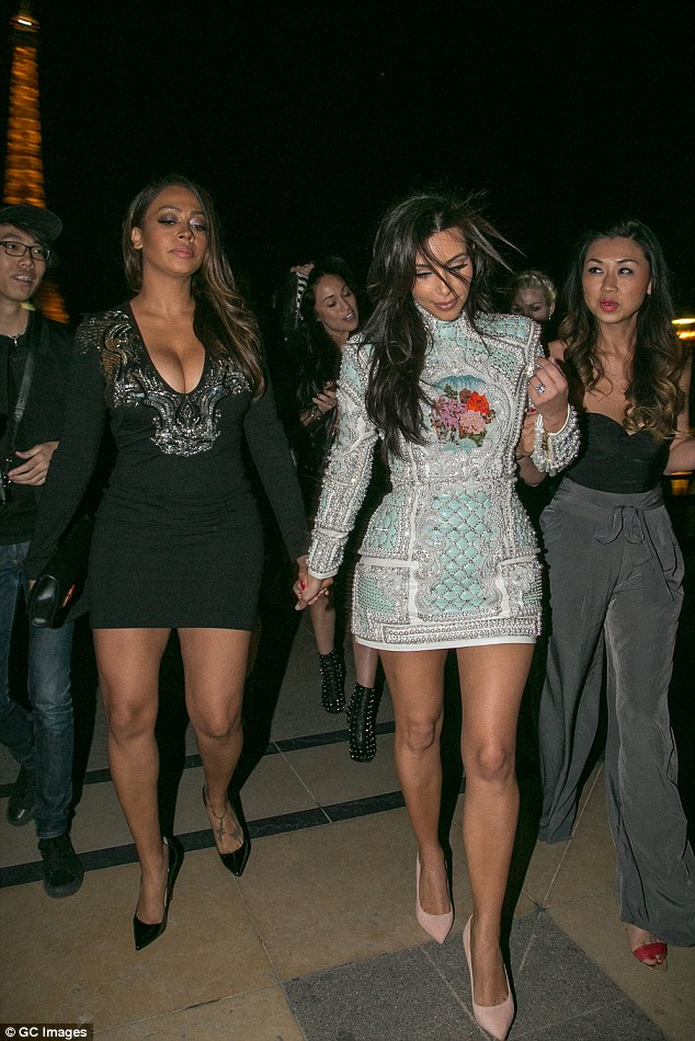 Hold on: After the group enjoyed 15 bottles of champagne, the bride-to-be held her BFF LaLa Anthony's hand