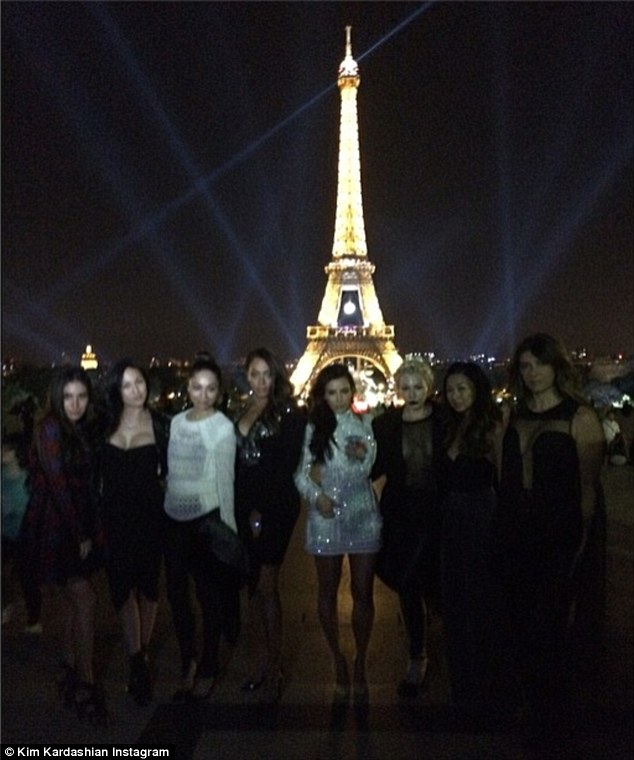City of Lights: The ladies took multiple photos in front of the Eiffel Tower