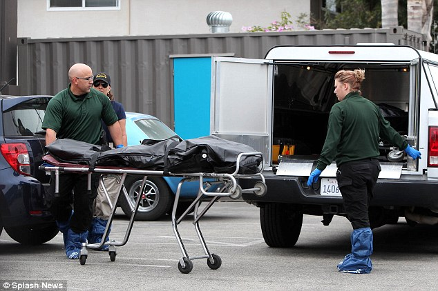 More casualties: Coroners remove three bodies from the Capri Apartment building in Isla Vista where Elliot Rodger reportedly lived