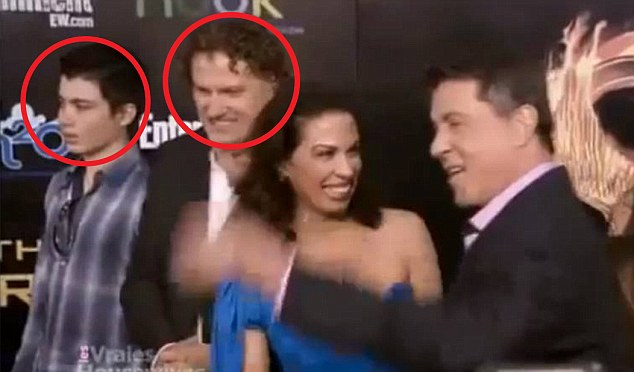 Dystopian fantasy: Elliot Rodger (seen left) is the son of Peter Rodger, assistant director for The Hunger Games (seen second left), about an annual televised death match. Elliot Rodger is seen here at the film's 2012 premiere with Sylvester Stallone (right)
