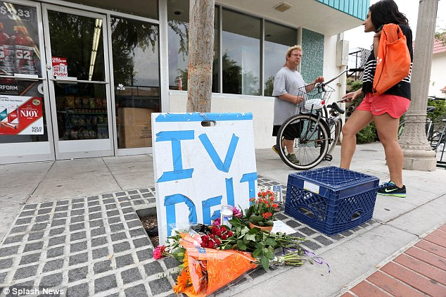 Aftermath: Students and shop owners survey the damage caused by the gunman which spread over several streets in Isla Vista