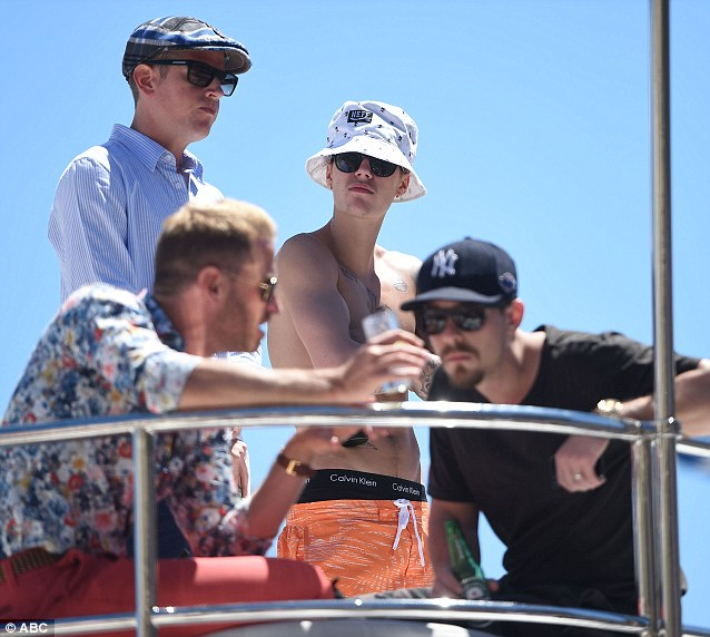 Pensive: Justin looked like he was deep in thought as he was joined aboard the yacht with some friends