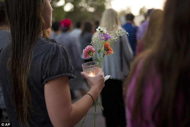 Solemn procession: The participants of the vigil marched to the scene of the grisly slayings in downtown Isla Vista
