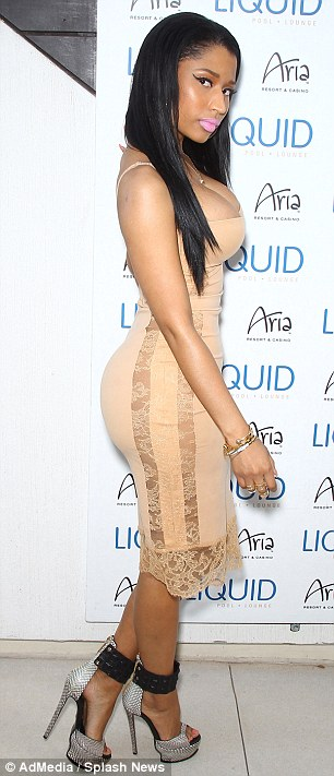 Flattering: Nicki showed off her stunning curves in the tight dress as she posed at the party spot