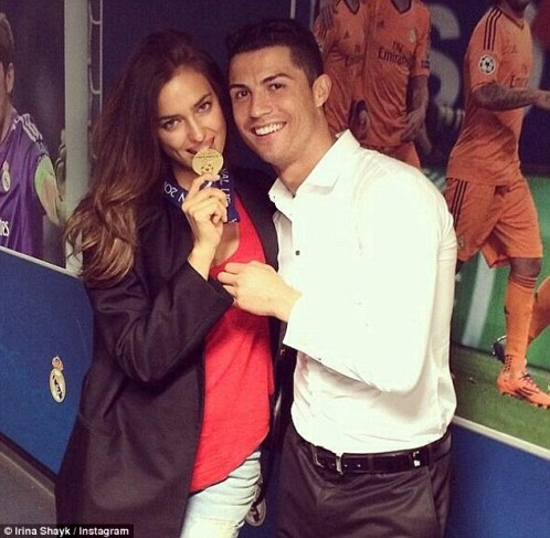 Golden couple: Ronaldo celebrates with his girlfriend Irina Shayk and his medal