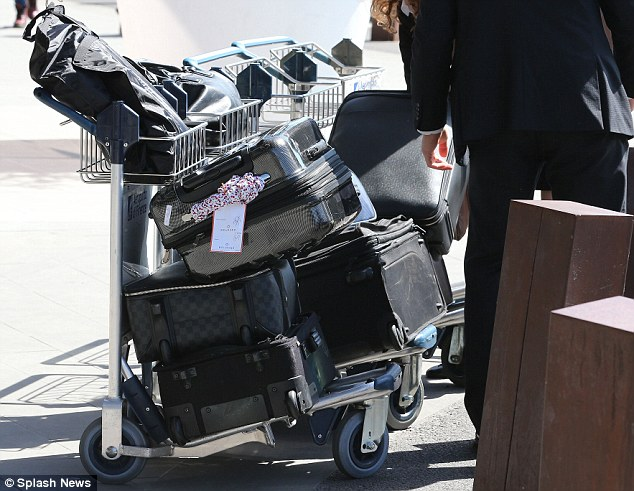 They don't travel light: Naturally, the family came with lots of luggage