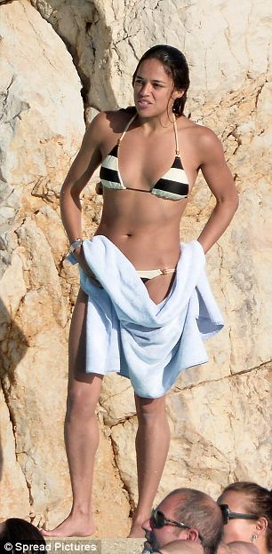 Slender: The actress showed off an enviable figure in her tiny monochrome striped bikini