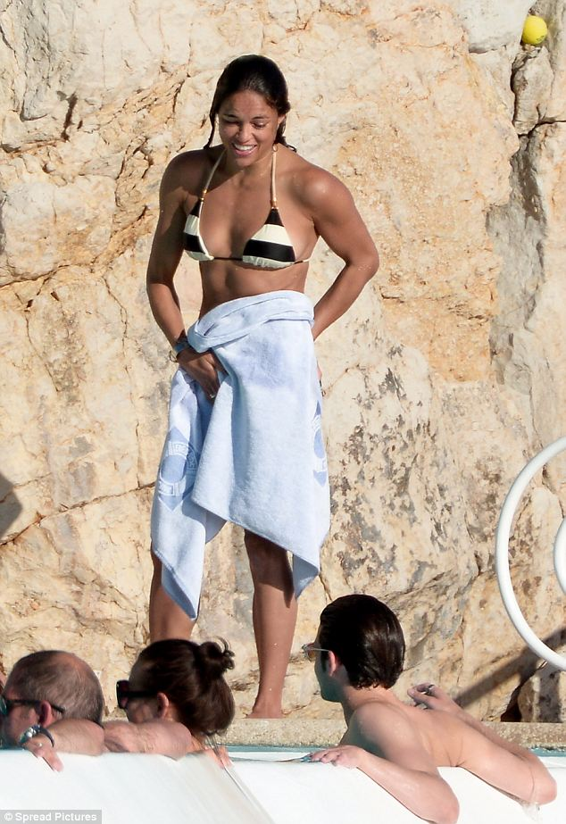 Sun-kissed: Michelle sported a light tan as she enjoyed the warm continental weather