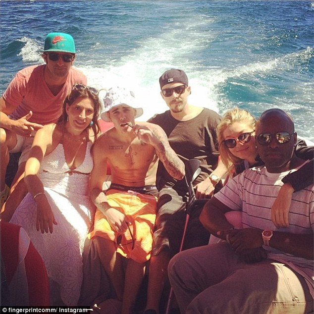 Ready to mingle: Cody Simpson's ex, 19-year-old model Gigi Hadid, hung out with a shirtless Justin Bieber, 20, on a yacht off the coast of France on Saturday