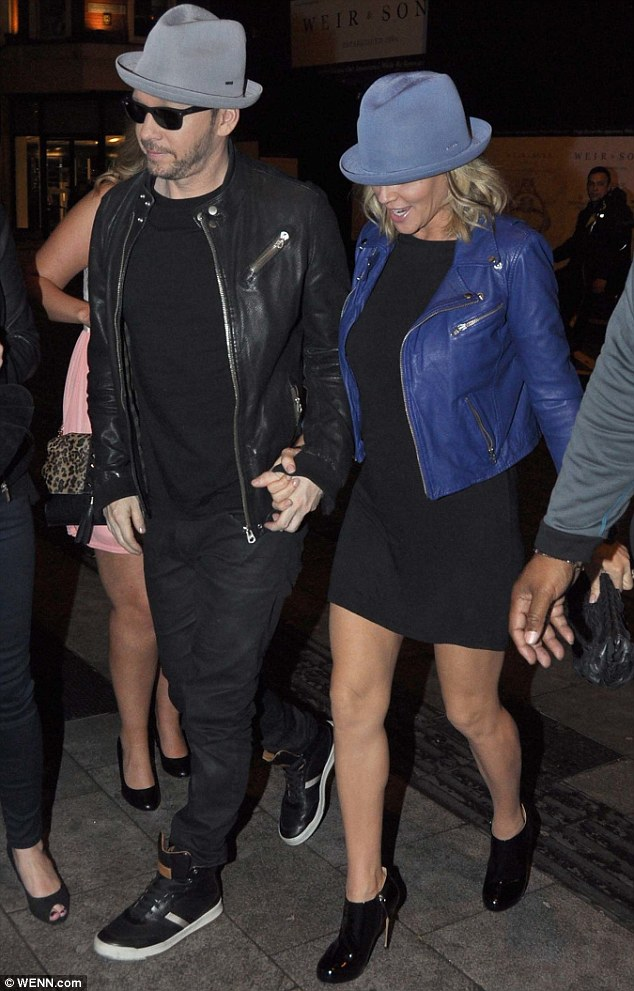 Leggy look: Jenny wore a short skirt to show off her toned legs, while her fiance went casual