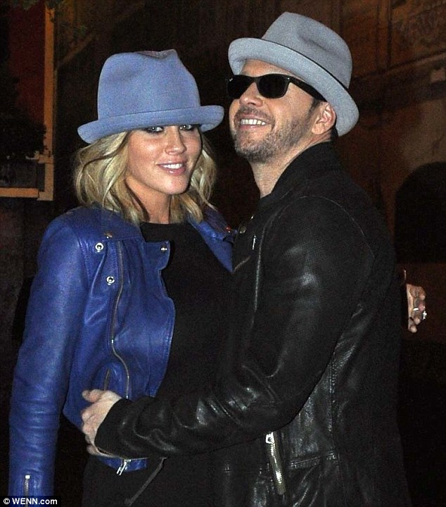 Hats off: Jenny McCarthy and Donnie Wahlberg enjoy a night out at Lillies Bordello in Dublin