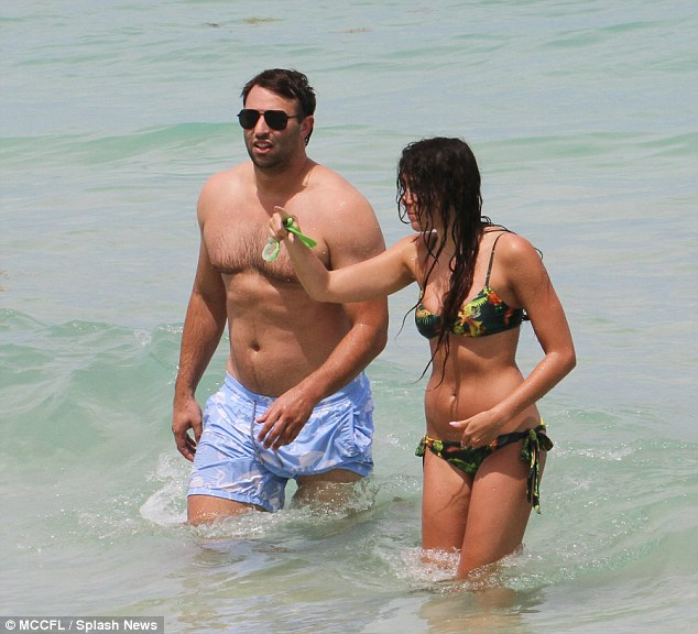 Take a look: The singer was perhaps trying to locate her spot on the beach