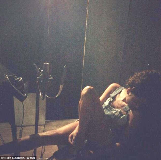 Studio nights: Eliza uploaded a picture looking tired in the studio booth with the caption: 'Friends don't let friends fall asleep at the mic