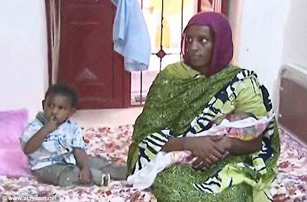 To be freed: Meriam Ibrahim, pictured here holding her newborn daughter, will be released from prison, according to reports