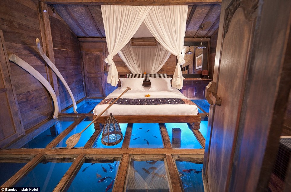 Dazzling: Visitors to the Bambu Indah hotel in Bali can step out of bed onto a glass floor above a stunning underwater panorama of a fresh shrimp pond