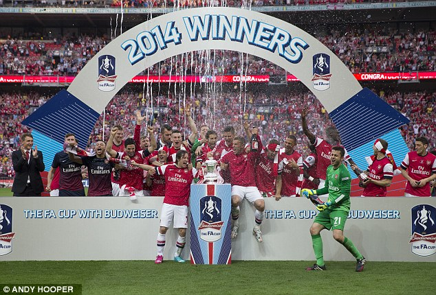 Similar outcome: Arsenal's men's team celebrate winning the FA Cup at Wembley last month