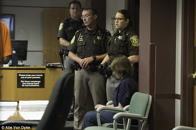 Sheriff's deputies tower over one of the 12-year-old suspects in the Slender Man stabbings