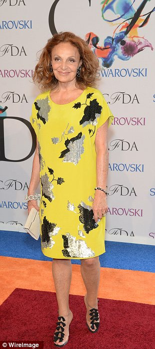 Simple and elegant: Diane von Furstenberg chose a pretty patterned yellow dress which highlighted her slim figure and if her smile was anything to go by, she knew she looked good
