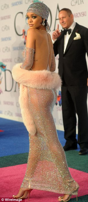 Leaving nothing to the imagination: Rihanna opted for just a sheer embellished backless halter dress which showed off every inch of her body as she was honoured at the CFDA awards on Monday