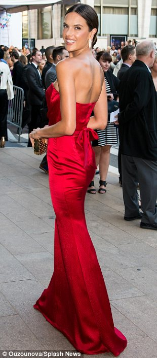 Lady in red: Victoria's Secret model Alessandra Ambrosio opted for a strapless red floor length Nonoo gown which showed off her flawless figure and deep tan