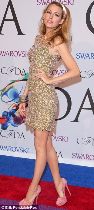 Short and sweet: Blake Lively stood out amongst all the floor length wearing stars by making it short and sweet in her Sixties style minidress from designer Michael Kors