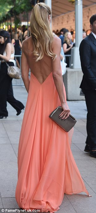 Amazonian beauty: Supermodel Heidi Klum looked amazing in her flowing peach Donna Karan  dress which showed off her tanned, toned body in all its glory