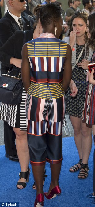 Fashion fail: Fashion darling Lupita Nyong'o made a rare fashion fail in an unflattering pair of cropped trousers and matching top from Suno on the same day her new role in Star Wars was announced