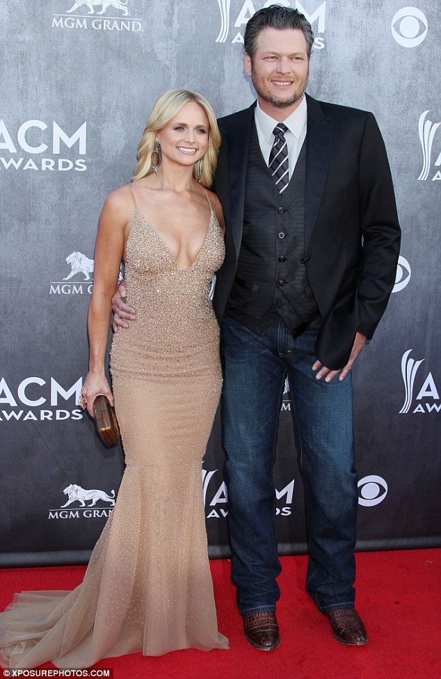 Happy couple: The 30-year-old country music star pictured with husband Blake Shelton, 37, at the Academy of Country Music Awards n Las Vegas in April