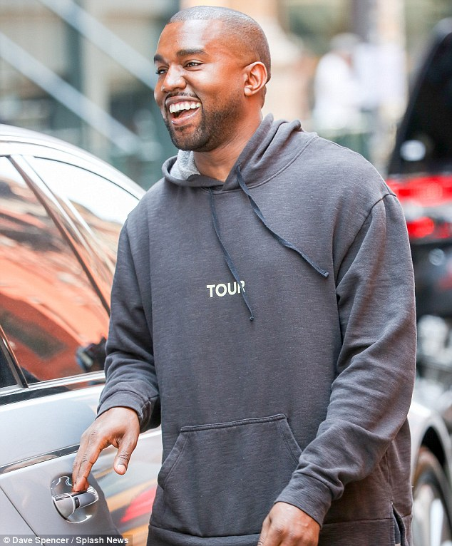 He's so happy: Kanye West seemed to be loving married life so much the normally dour rapper broke out into actual laughter on a shopping trip in New York on Tuesday