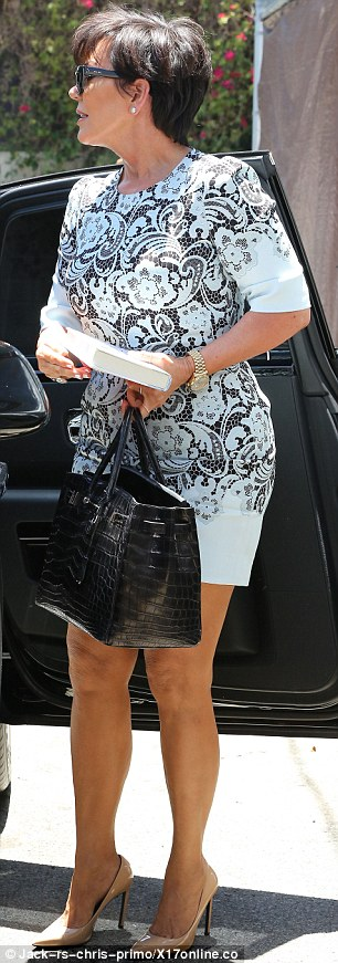 Letting the side down: Kris Jenner showed off her legs for the occasion as she joined her daughter Kim