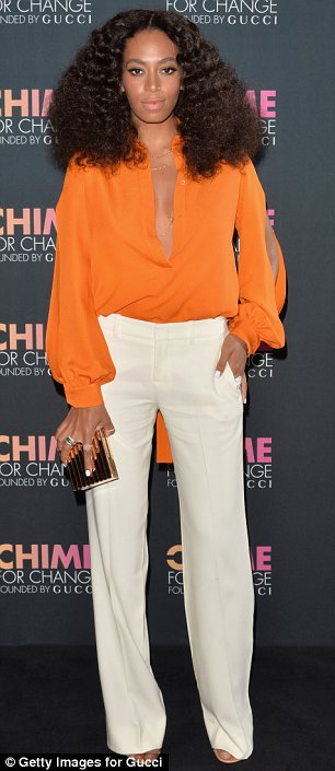 Taking the plunge: Beyonce, sans her new braids, and sister Solange, both attended the Chime For Change anniversary party in plunging outfits on Tuesday