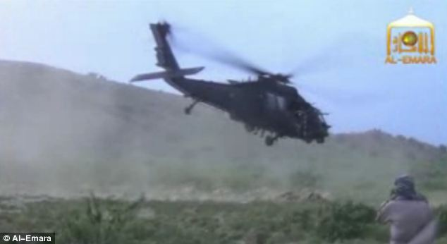 Bergdahl is led into the helicopter which then takes off and flies away