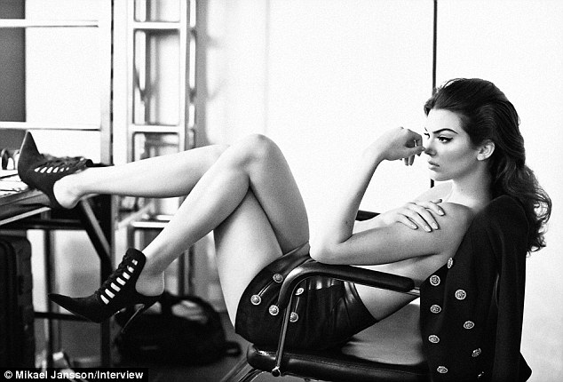 All grown up: As if declaring she is a model now, the 18-year-old the reclines on a chair wearing nothing but leather hot pants in one image
