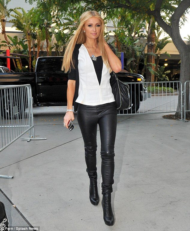 Aren't you a tad overdressed? Paris Hilton wore skintight leather trousers and heavy eye make-up as she arrived at the Kings ice hockey game at the Staples Center in LA on Wednesday