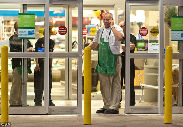 Lockdown: Employees of a grocery store lock down their store in Moncton, New Brunswick, after a shootout