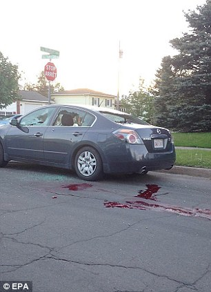 Gruesome: Twitter user Matt Arsenault/Laundromatt took this grisly image showing the scene of a shootout between police and a suspect that resulted in the reported deaths of three police officers