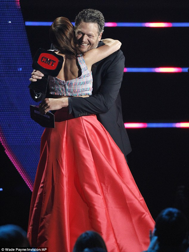 Proud of her: Blake Shelton handed his former The Voice protege Cassadee Pope a winner's gong at the CMT Music Awards in Nashville, Tennessee