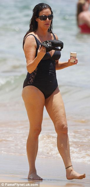 Stylish: The star's flattering swimsuit featured lace panels down the sides