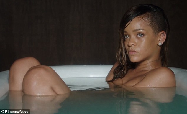 Laying it bare: Rihanna writhes around naked in a bathtub for her music video, Stay