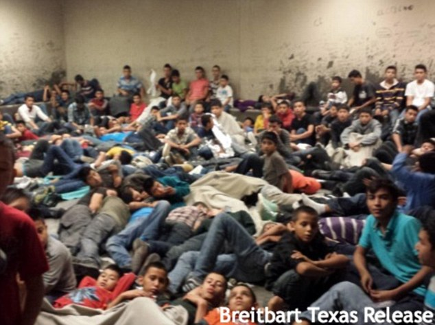 Overflowing: Immigration authorities have opened a shelter at Lackland Air Force Base in Texas to house a rising number of unaccompanied minors who have been crossing the U.S.-Mexico border illegally