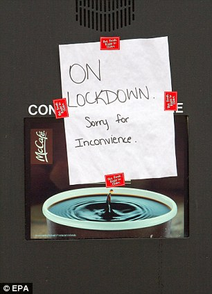 A McDonald's Restaurant on Mountain Road, in the lockdown area of Moncton, displays a sign apologizing for its closure in the midst of a manhunt for Justin Bourque