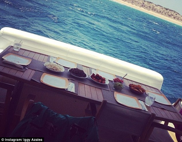 Al fresco: The hot couple enjoyed a feast with a stunning view