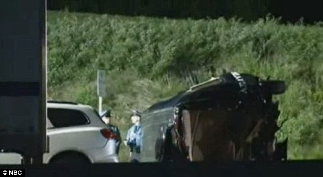 Crash scene: Morgan's crumpled limo-bus rests on its side as police arrive at the New Jersey Turnpike