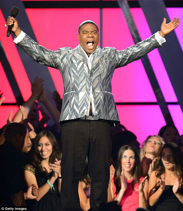 Critical: Comedian Tracy Morgan is in intensive care after his limo-bus flipped over during a six-vehicle pile up