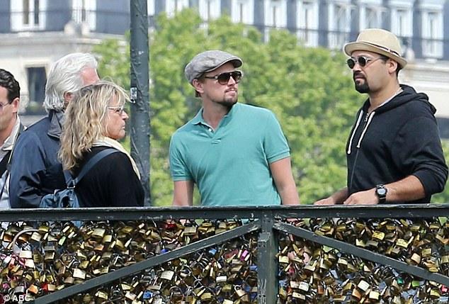 Actor Leonardo DiCaprio visits the iconic Pont des Arts with friends