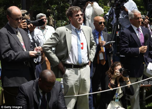Immediately contentious: Neil Munro (C), the White House Correspondent for the Daily Caller, peppered Obama with unexpected questions during the announcement, during which the president hadn't planned to take questions at all