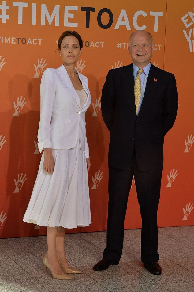 The 39-year-old actress will co-chair this week's summit in London. She dedicated her effort to end rape in war to a victim she met with Mr Hague (right)