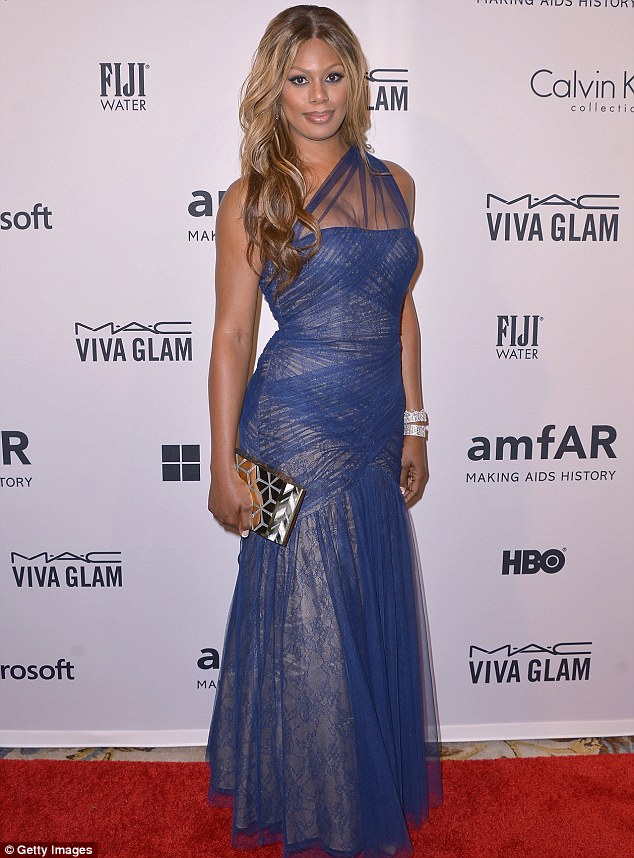 Midnight look: Orange Is The New Black star Laverne Cox sported a pone shouldered blue chiffon blue gown for the bash