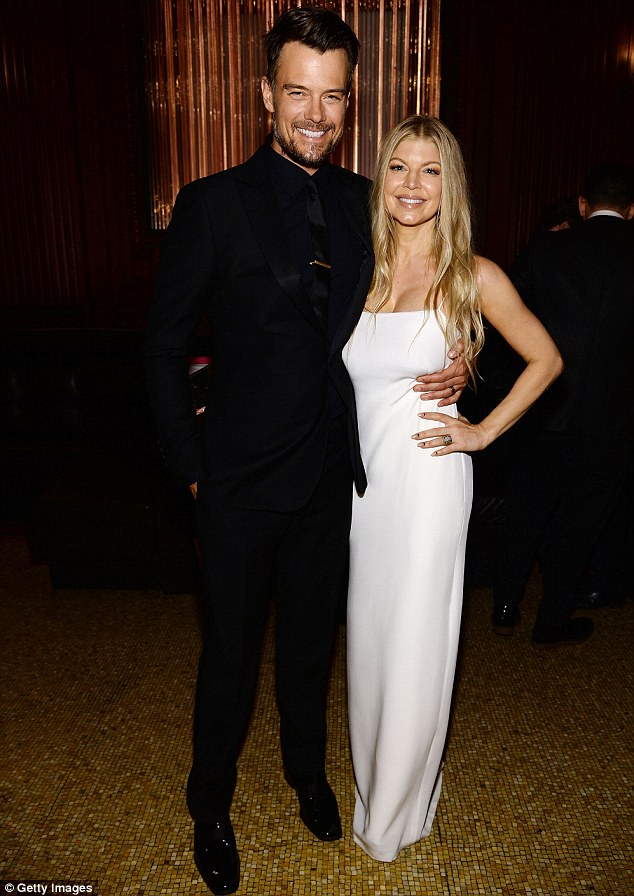 The host with the most: Fergie arrived with her husband Josh Duhamel who looked dapper in a black suit and shirt